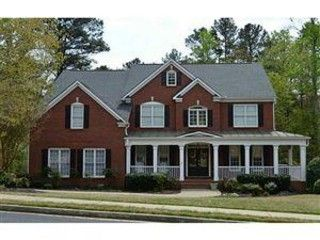 Wrap around porches bricks and porches on pinterest for Brick home plans with wrap around porch