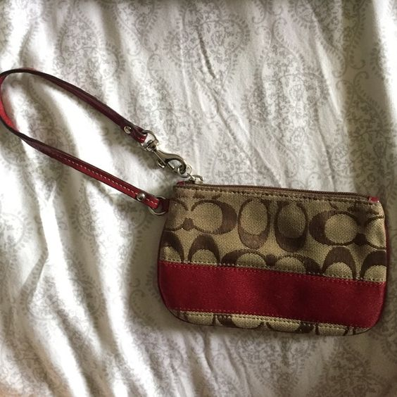 Coach Wristlet Very good condition! Missing the snap on Coach keychain thing. (it fell off somewhere). Leather wristlet part is in tip top shape! No cracks in the leather. Coach Bags Clutches & Wristlets