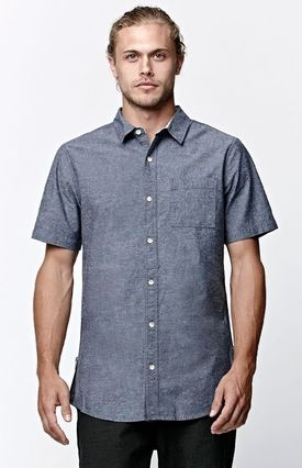 On The Byas updates a classic chambray look with this men's button down shirt. The Chambray Zip Woven Shirt comes with a comfortable knit body featuring a matching chest pocket and split zippered seams. #youhabit #7p5LGPMWd