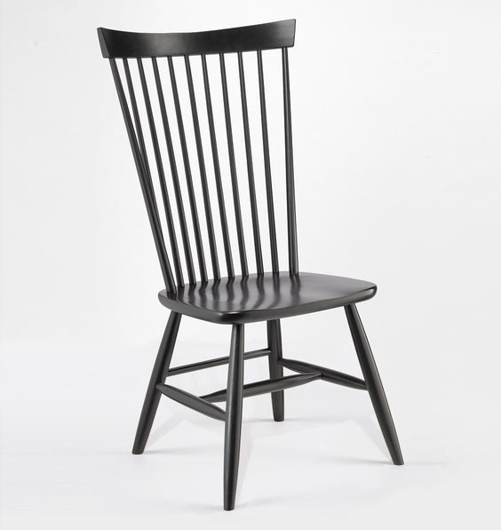 Rejuvention : HIGH BACK CHAIR Item # D1123 Black $379.00 This item ships with Unlimited Flat The quintessential Colonial era design, our High-Back Chair is crafted in West Virginia of sustainably harvested Appalachian maple. It is thought that 16th-century wheelrights introduced the practice of turning chair spindles on a lathe, as they turned spokes for wheels. Because the spindles and legs are round-tenoned, or fit into drille