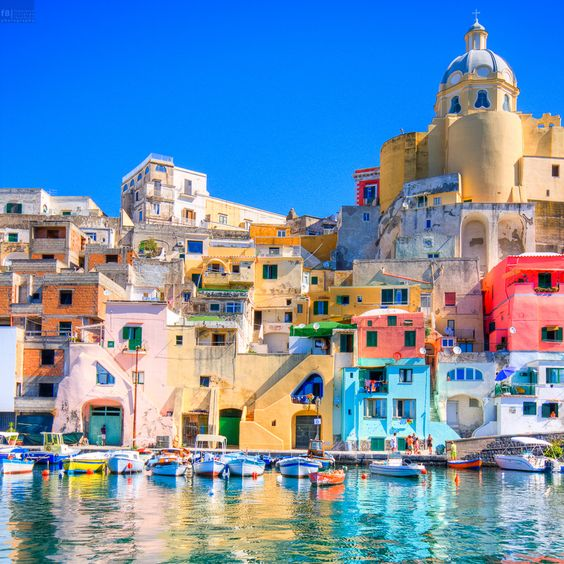 Procida (Italy). 'Wind-swept and citrus-scented, tiny Procida oozes old-school southern Italian appeal. Faded gelato-hued houses crowd the marina as a first evocative introduction to an island where tourism has remained remarkably low-key. Narrow strung-with-washing lanes beckon strollers to the backstreets, secret swimming spots make for summertime bliss.'