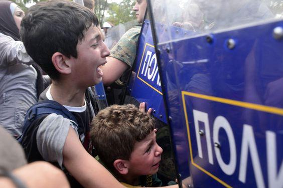 Macedonian police block migrants  at the Macedonian-Greek border 2015.