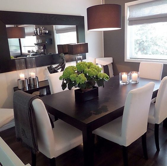 dining room dark wood table with white cloth chairs modern sleek