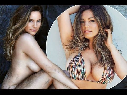 Kelly Brook poses NAKED on the beach for her calendar as she makes socia...