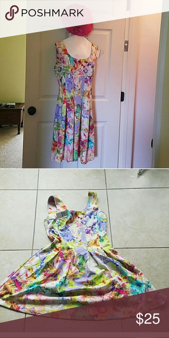 BNWT Neiman Marcus Dress Looks like Lilly Pulitzer and could be worn to the Kentucky Derby. It is size Large (12-14) Too large for me. Color is light purple with flowers. Still has tags! Neiman Marcus Dresses