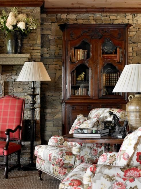 Red, white, olive green and tan living room with stone fireplace -- interior design: Francie Hargrove