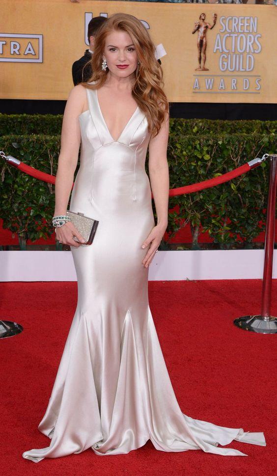 Pin for Later: Ein Tribut an Oscar de la Renta und seine schönsten Kleider auf dem roten Teppich Isla Fisher Isla trug ein Kleid aus der Herbstkollektion 2014 bei den Screen Actors Guild Awards in diesem Jahr.