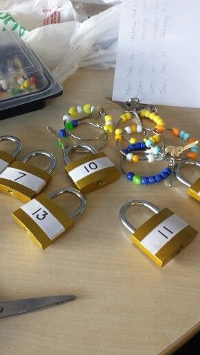 Math. Key and lock. Fine motor skills. 6 different dollar store locks. Put keys on binder rings with beads. Students must count the beads on the key ring and use the key to unlock the corresponding lock.