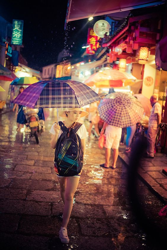 I loved walking around this city in the rain. The colors and the umbrellas were so fun to photograph. I loved using the Leica f/1.4 at 35mm wide open. It made for nice quick shots. I, unapologetically, enjoy taking photos of interesting people. I'd say it's about 70% girls and 30% guys. - Yangshuo, China - Photo from #treyratcliff Trey Ratcliff at http://www.StuckInCustoms.com