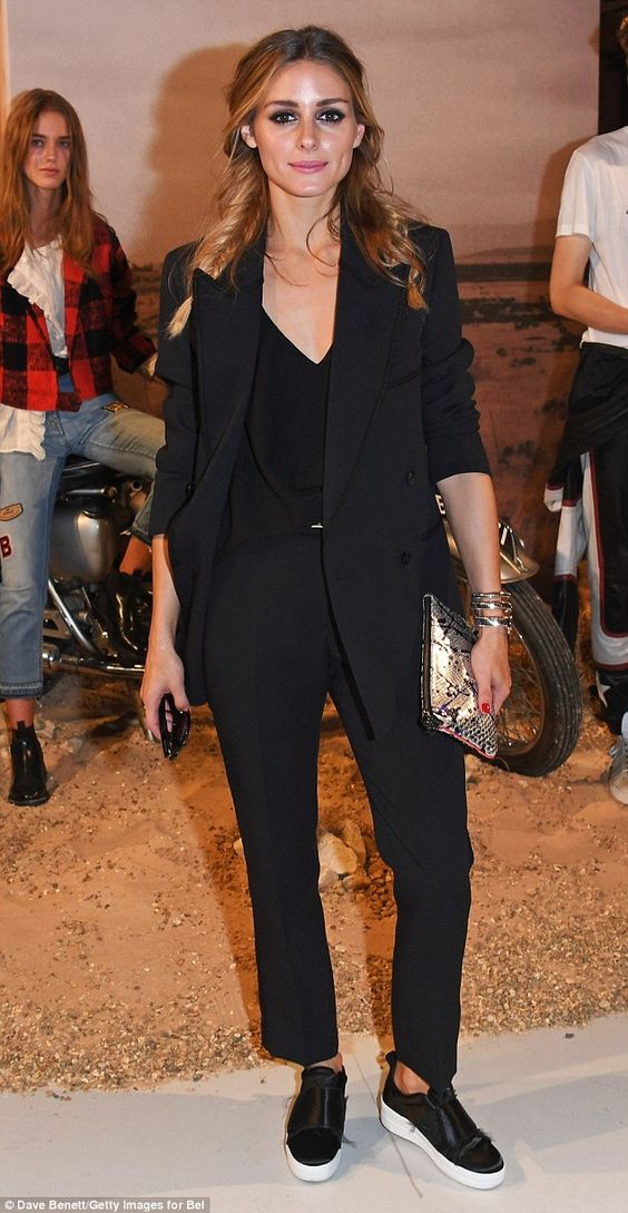Twice as nice: The fashionista then swapped the look for a chic trouser suit as she ventured to the view the Belstaff and Liv Tyler capsule collection and the Paul Smith SS17 showcase