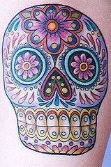 Sugar Skull tattoo. Ive seen alot of girls getting these on their arms. I havent actually looked at one closely before. Their really quite stunning.