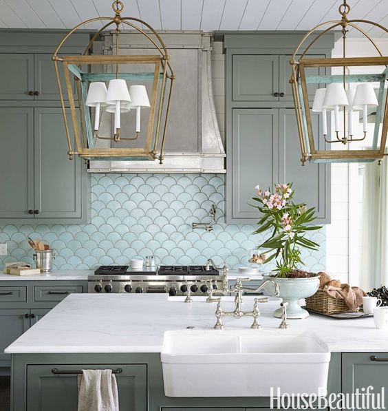 Kitchen - gold/ verdigris-blue lanterns, cabinet color (Retreat by Sherwin-Williams), backsplash, cabinet trim, paneled ceiling, farmhouse sink, marble counters, brushed stainless steel range hood | Urban Grace Interiors | House Beautiful: