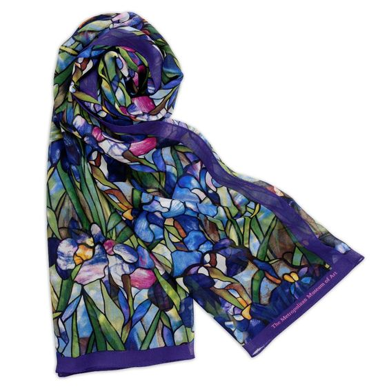 Featuring lush, radiant colors, this elegant scarf is based on Louis Comfort Tiffany's (American, 1848–1933) Magnolias and Irises Favrile glass window.