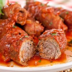 Beef Braciole. These slow-cooked beef rolls stuffed with proscuitto and basil are the centerpiece of a traditional Italian Sunday dinner.