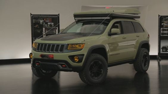 2015 Easter Jeep Safari Concepts: Jeep Grand Cherokee Overlander - a unique take on the company's largest SUV. It wears Sage Green paint, with a custom front fascia, winch, tow hooks, SRT tail lamps & hood, off-road rock rails, skid plates, 18-inch wheels with all-terrain tires, & more. Under the hood is Jeep's 3.0-liter diesel V6 with an 8-speed automatic transmission. And to top it all off, there's a two-person, hard-shell rooftop tent.