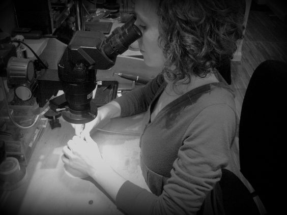 Jessica Poole working at the bench, setting gemstones with the use of a microscope.  A highly specialised technique that Jessica learnt through intensive training in Antwerp, Belgium www.jessicapoole.co.uk