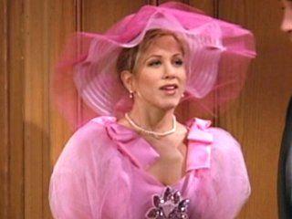 Rachel Green as a bridesmaid...pink pepto dress