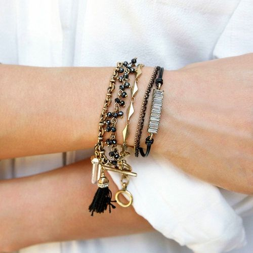 Toggle up this season in our latest arm party favorite, featuring two pretty + petite removable charms: an on-trend rock crystal + threaded black tassel! Perfect for both casual days + elegant evenings, discover the versatile styling possibilities of this naturally stunning beauty.