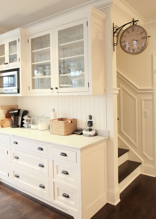 White kitchen. Love the clock!