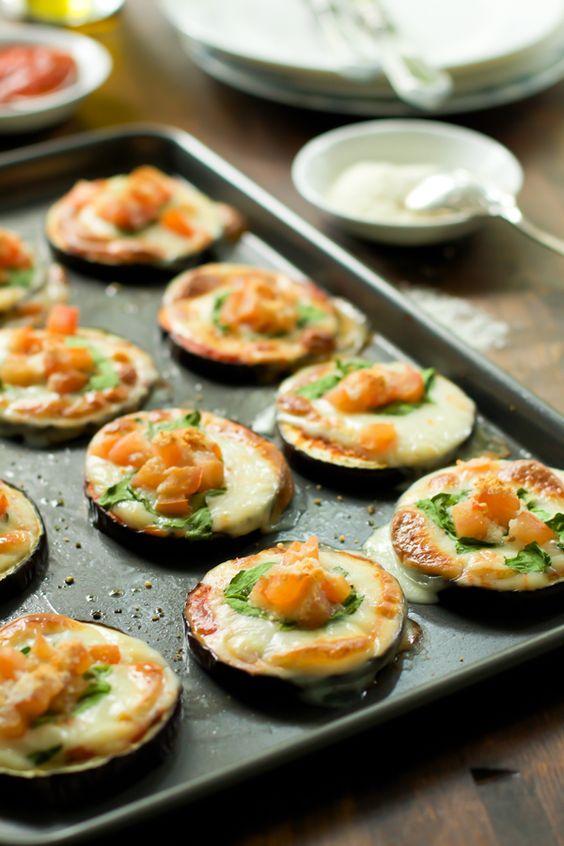 Eggplant Pizza Bites. Going to make this with Daiya mozzarella & nutritional yeast to Veganize!