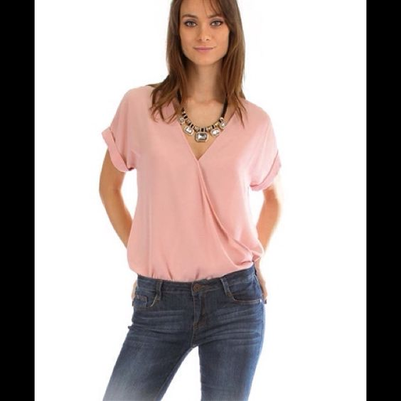ROSE HI-LOW FRONT DRAPPE BLOUSE Made In: USA Fabric Content: 100% POLYESTER Sizes: S-M-L Tops Blouses