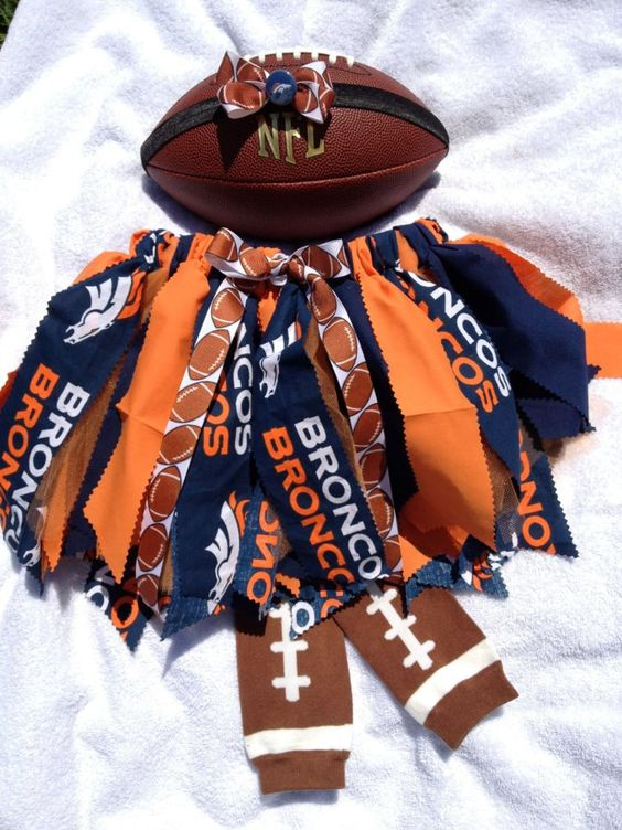 I know if we have a little girl Juan will want this for her.  NFL Fabric Tutu - Denver Broncos. $25.00, via Etsy.