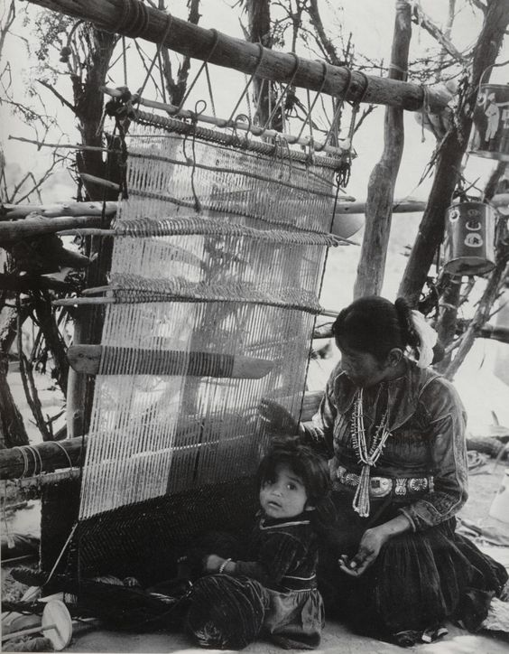 Navajo woman using a weaving loom, this picture reminded me of how far we have come in technology today.