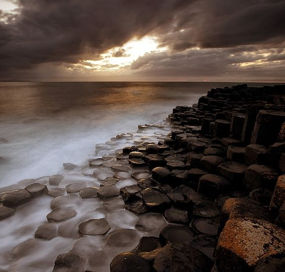 Giant's Causeway is an area of about 40,000 interlocking basalt columns on the northeast coast of Northern Ireland. It is the result of an ancient volcanic eruption, and the tops of the columns form stepping stones that lead from the cliff foot and disappear into the sea. The tallest columns are about 39ft high.