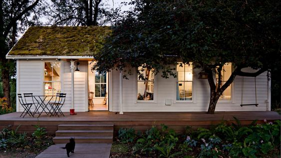This tiny home is just 540-square-feet and houses a family four that's trying to life all about sustainability. Take a tour inside.