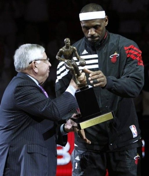 NBA Commissioner David Stern, left, hands Miami Heat forward LeBron James his NBA MVP trophy before the start of Game 1 in an NBA basketball Eastern Conference semifinal playoff series against the Indiana Pacers, Sunday, April 13, 2012, in Miami.