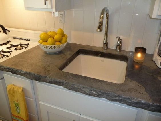 love the rough edges on the poured concrete countertops