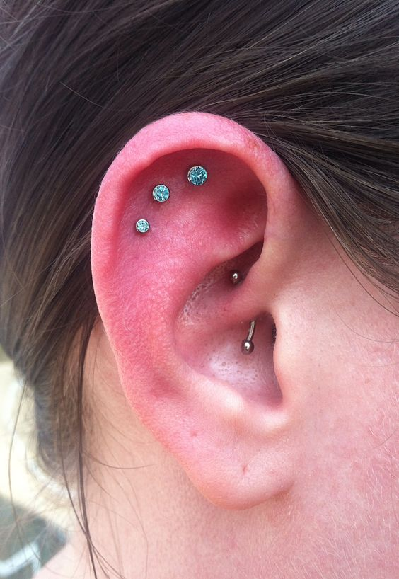 Triple outer conch I did while doing a guest spot at Iris Piercing in Denver. 18g Neo Metal barbells with Mint Green gems.