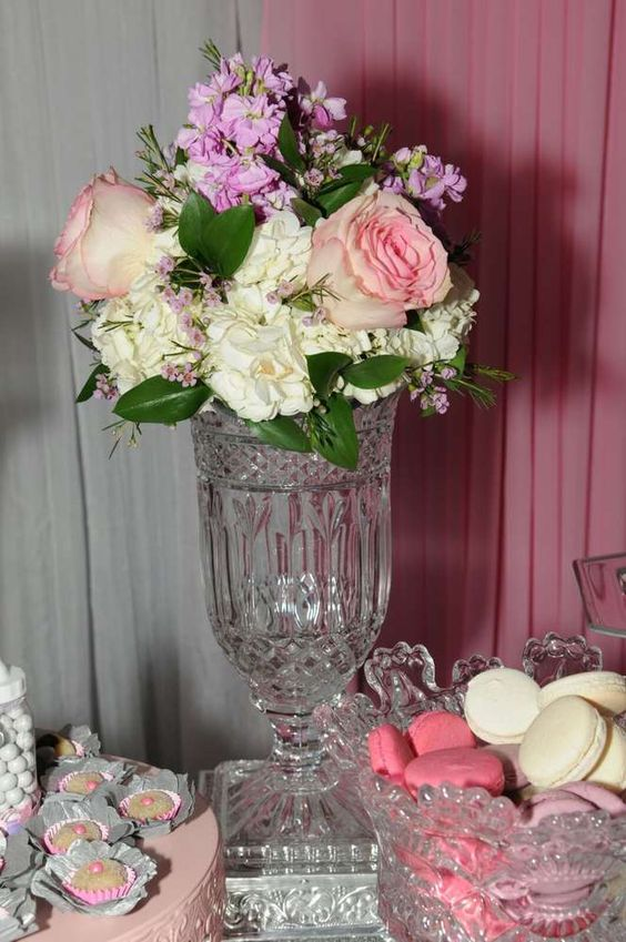 Floral centerpiece at a baby carriage baby shower party! See more party planning ideas at CatchMyParty.com!