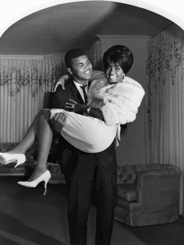 Isaac Sutton/EBONY Collection - Muhammad Ali is photographed carrying then wife, Sonji Clay, over the threshold after their wedding.: