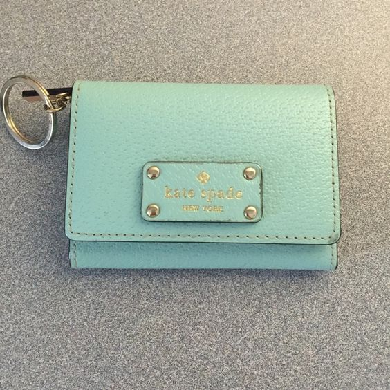 Kate Spade keychain wallet Light blue Kate Spade key chain wallet. I've carried a couple of times, just don't get enough use out of it! kate spade Bags Wallets