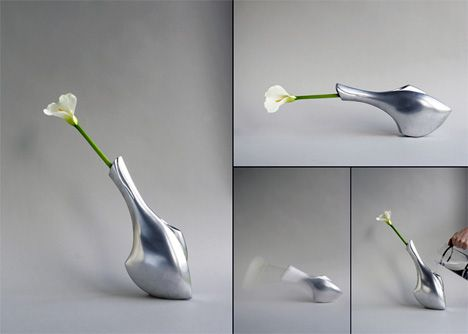 The action of this vase illustrates the state of the flower within / David Sweeney