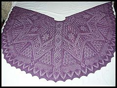 """Finished size: 37"""" long x 75"""" wide. This shawl is laid out on a king size bed!  27 days to knit."""