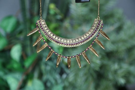 This fierce accessory will bring out the warrior in you. A bib style necklace is finished with dangling feather beads for a strong statement in forward-thinking fashion ~ Fair trade style is perfect for your journey