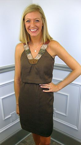 For those of you who prefer more classic styling with a longer hemline will love this new dress! After trying it on for the photo, Kimberly didn't want to take it off! It is a double layer cotton with elasticized waist and a gorgeous beaded neckline! Make it casual with cowboy boots or dress it up with bronze heels. (You will not need a slip under this.)