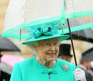 The Queen's matching outfit, hat and umbrella.
