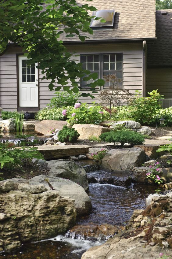 Waterfalls bridges and stones on pinterest for Backyard streams and waterfalls