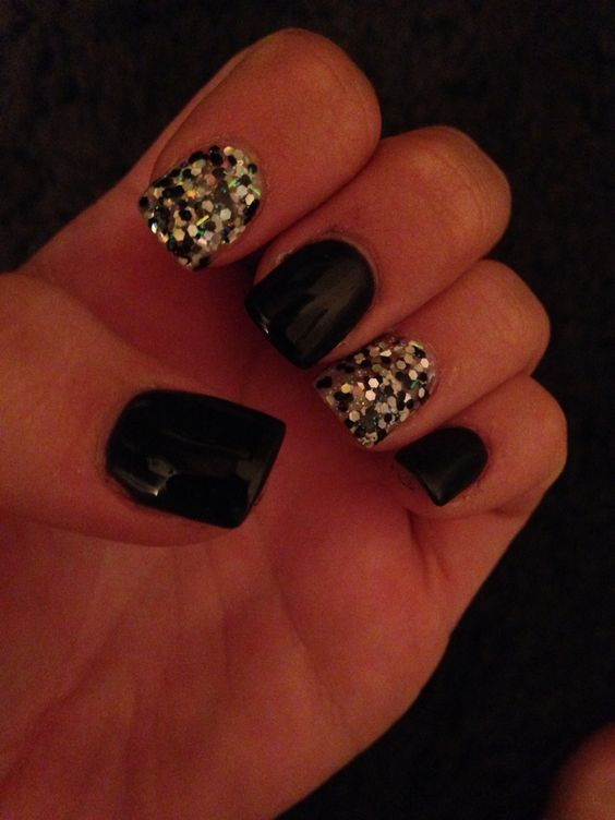 Got my nails done love them so much black with large sparkles