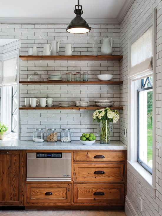Wood cabinets, open shelving + subway tile: