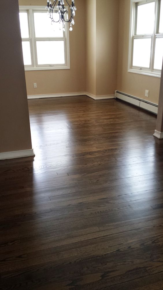 Minwax Jacobean Satin finish hardwood floors...living room looking into dining room/eik
