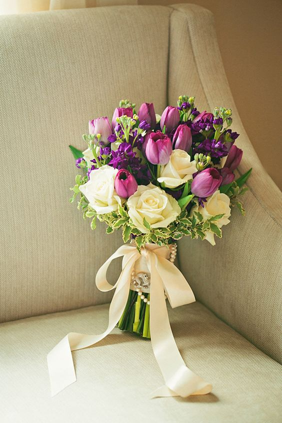 Pretty purple bouquet perfectly tied with a satin ribbon ...