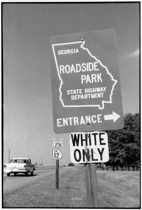 """Constantine Manos USA. Georgia. Highway Dept. roadsign reading """"Entrance, White Only."""""""