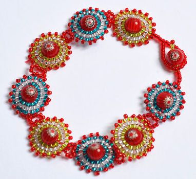 Imagine it as a necklace in Browns/Reds, Whites and Blacks (like an African Queen!):