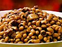 New Year's Day 2016:  Emeril's Smoked Sausage and Black-Eyed peas.  If you soak the peas, reduce the water by a couple of cups.  Mine was a little too soupy, BUT were still fantastic!