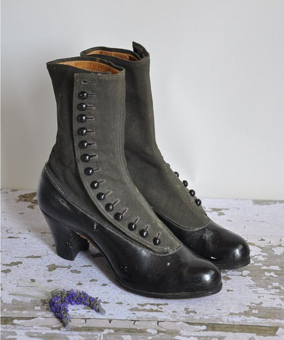"""Vintage rare 1900s black button down boots. The inside is lined beautiful with leather and is stamped with the designer """"Peters"""" Around the feet is black leather with a dark green canvas material. Wood soles."""