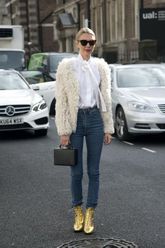 50 Jeans Outfits to Copy This Fall - Shaggy fur coat, high-waist denim, and amazing lace-up gold ankle boots